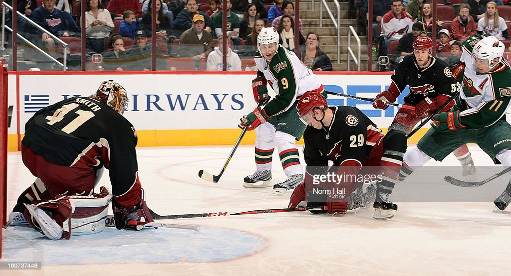 Michael Stone #29 of the Phoenix Coyotes drops down to block a shot in front of goalie Mike Smith #41 against the Minnesota Wild at Jobing.com Arena on February 4, 2013 in Glendale, Arizona.