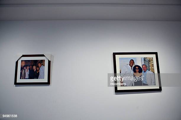 Michael Strahan, a former New York Giants defensive lineman, appears in photographs hanging in the apartment of Marc Dreier, founder of the law firm...
