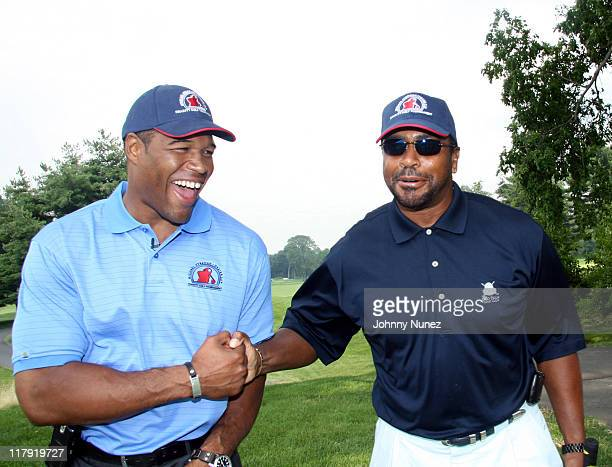 Michael Strahan and Ahmad Rashad during Michael Strahan Dreier LLP First Annual Golf Tournament at Century Country Club in Purchase New York United...