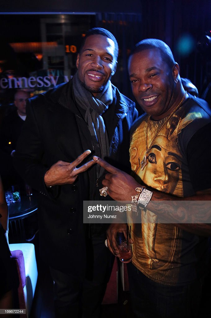 Michael Strahan and Busta Rhymes attend Hennessy vs Introduces Nas As Newest Partner at R Lounge at the Renaissance New York Times Square Hotel on January 15, 2013 in New York City.