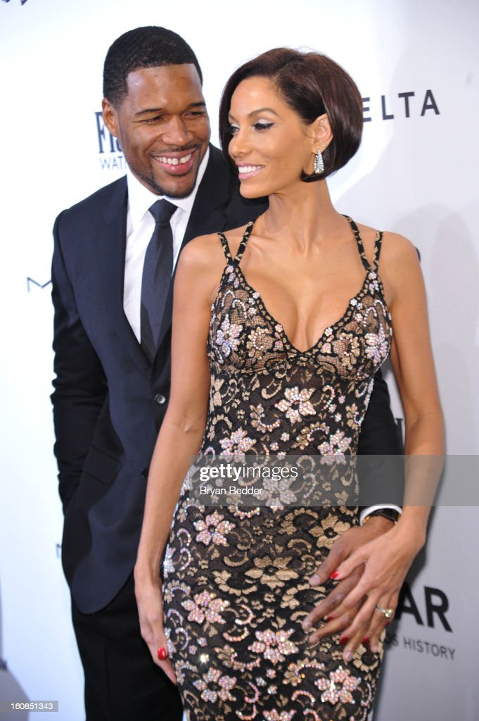 Michael Strahan (L) and Nicole Murphy attend the amfAR New York Gala to kick off Fall 2013 Fashion Week at Cipriani Wall Street on February 6, 2013 in New York City.