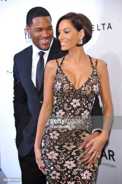 Michael Strahan and Nicole Murphy attend the amfAR New York Gala to kick off Fall 2013 Fashion Week at Cipriani Wall Street on February 6 2013 in New...