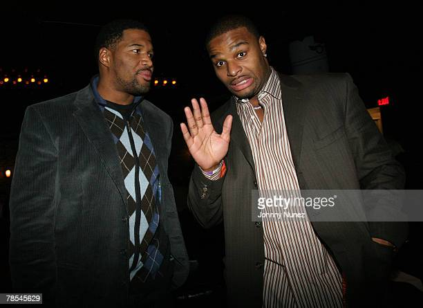 Michael Strahan and Osi Umenyiora attend Michael Strahan's Santa's BIG Helper Christmas Party at Club Slate December 17 2007 in New York City