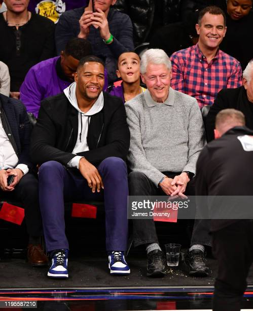 Michael Strahan and President Bill Clinton attend Los Angeles Lakers v Brooklyn Nets game at Barclays Center on January 23 2020 in New York City