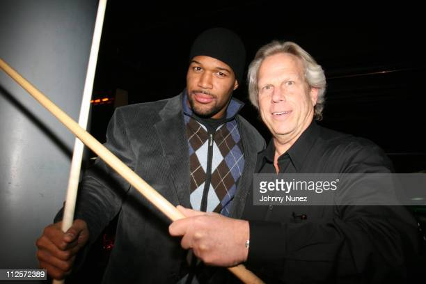 Michael Strahan and Steve Tisch attend Michael Strahan's Santa's BIG Helper Christmas Party at Club Slate December 17 2007 in New York City
