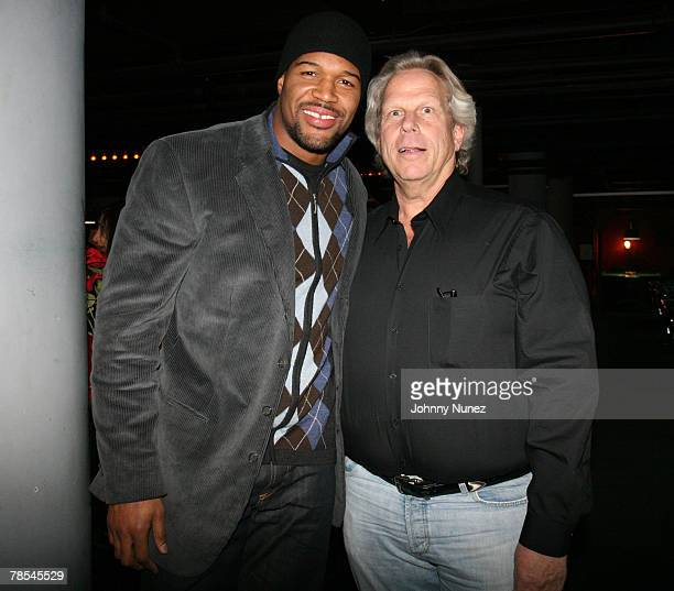 Michael Strahan and Steve Tish attend Michael Strahan's Santa's BIG Helper Christmas Party at Club Slate December 17 2007 in New York City