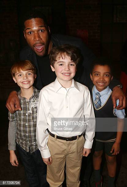 Michael Strahan and the kids of the cast pose backstage at the hit musical Kinky Boots on Broadway at The Al Hirshfeld Theatre on March 23 2016 in...