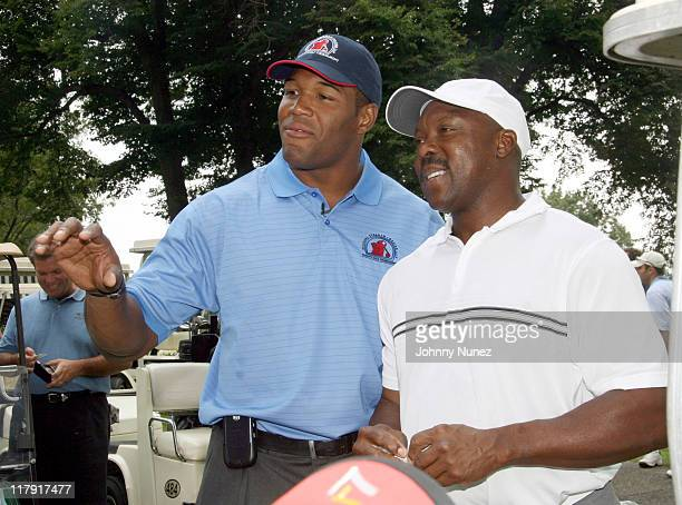 Michael Strahan and Vince Coleman during Michael Strahan Dreier LLP First Annual Golf Tournament at Century Country Club in Purchase New York United...