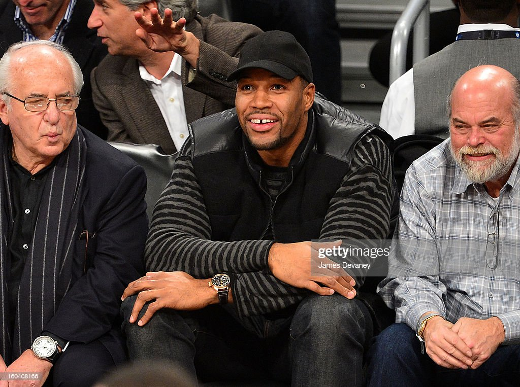 Michael Strahan attends the Miami Heat vs Brooklyn Nets game at Barclays Center on January 30, 2013 in the Brooklyn borough of New York City.