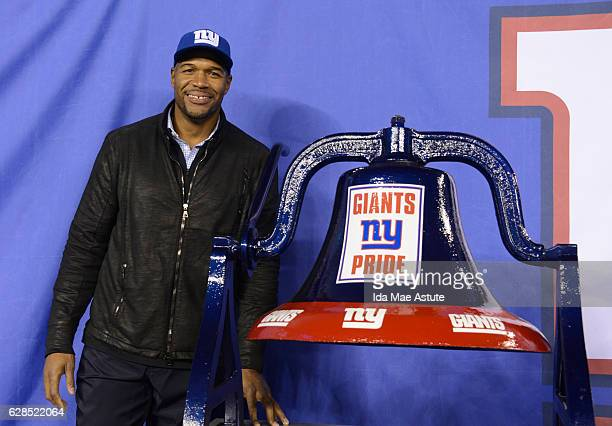 Michael Strahan from GOOD MORNING AMERICA, inducts New York Giants legends into the Ring of Honor at MetLife Stadium during the NY Giants vs....