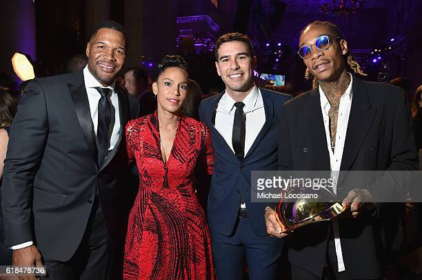 Michael Strahan Grace Raymond Adam Braun and Wiz Khalifa attend Pencils of Promise 6th Annual Gala 'A World Imagined' at Cipriani Wall Street on...