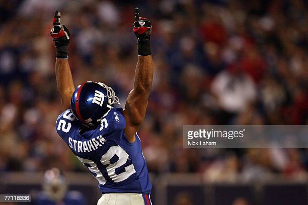 Michael Strahan of the New York Giants celebrates in the second quarter after becoming the Giants all time sack leader against the Philadelphia...