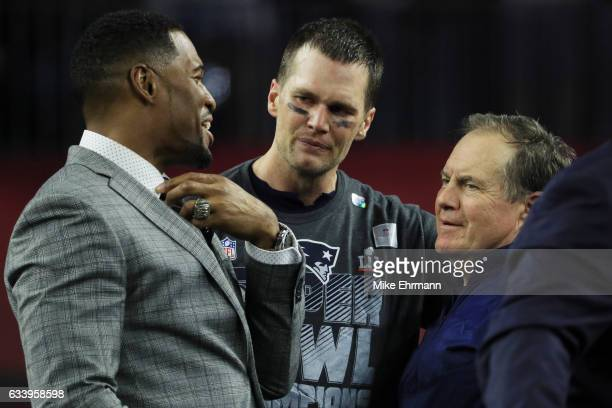 Michael Strahan Tom Brady and head coach Bill Belichick of the New England Patriots reacts after defeating the Atlanta Falcons 3428 in overtime...