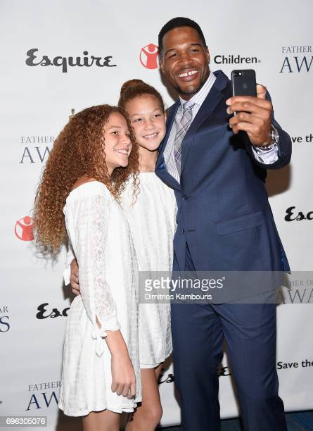Michael Strahan with daughters Isabella Strahan and Sophia Strahan attend The 76th Annual Father Of The Year Awards at New York Hilton on June 15...