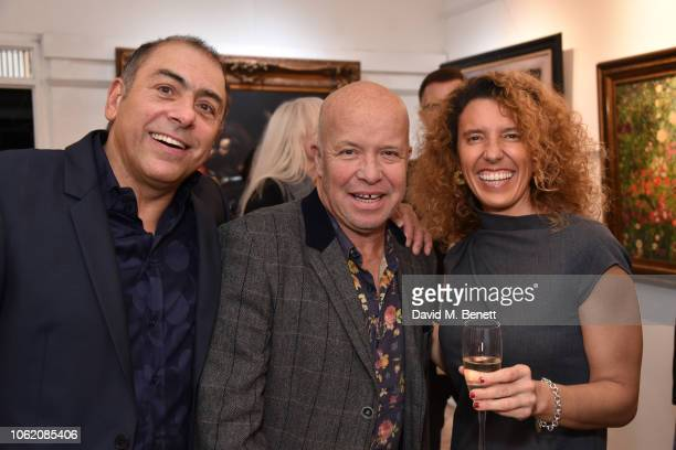 Michael Stravrides Paul Karslake and Francesca Rubulotta attend a private view of artist Paul Karslake's exhibition at The Marylebone Gallery on...