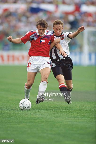 Michael Streiter of Austria challenges Milan Luhovy of Czechoslovakia during their Group A match of the 1990 FIFA World Cup on 15 June 1990 at the...
