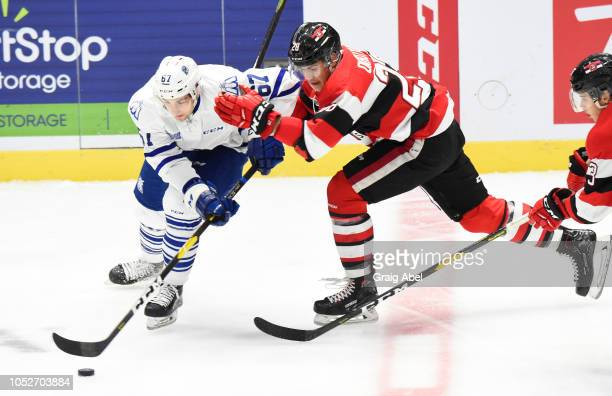 Michael Stubbs of the Mississauga Steelheads battles for the puck against Nikita Okhotyuk of the Ottawa 67sduring OHL game action on October 21 2018...