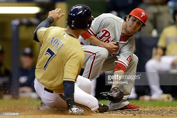 Michael Stutes of the Philadelphia Phillies tags out Norichika Aoki of the Milwaukee Brewers while trying to steal home plate on a pass ball in the...