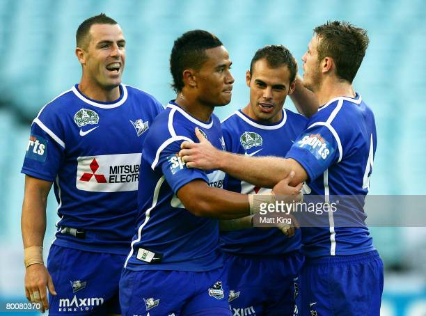 Michael Sullivan of the Bulldogs celebrates with team mates after scoring a try during the NRL trial match between the Bulldogs and the Penrith...
