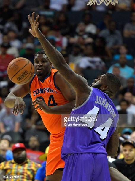 Michael Sweetney of 3's Company makes a pass around Ivan Johnson of Ghost Ballers during week two of the BIG3 three on three basketball league at...