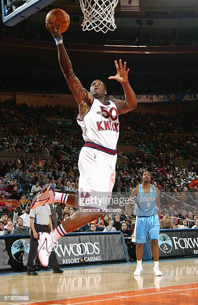 Michael Sweetney of the New York Knicks shoots against the Denver Nuggets during the game at Madison Square Garden on December 12 2004 in New York...
