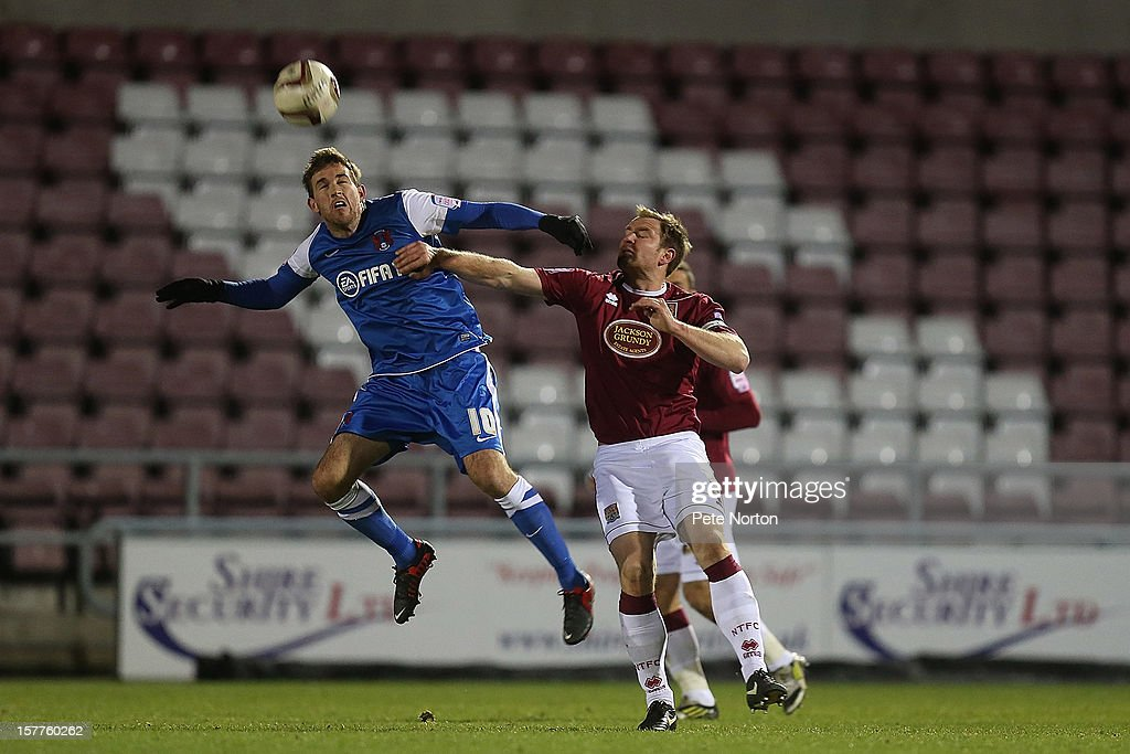 Michael Symes of Leyton Orient attempts to head the ball under pressure from Kelvin Langmead of Northampton Town during the Johnstone's Paint Trophy Quarter Final match between Northampton Town and Leyton Orient at Sixfields Stadium on December 5, 2012 in Northampton, England.