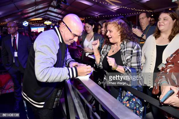 Michael Symon meets fans at the Food Network Cooking Channel New York City Wine Food Festival presented by CocaCola Rooftop Iron Chef Showdown Battle...