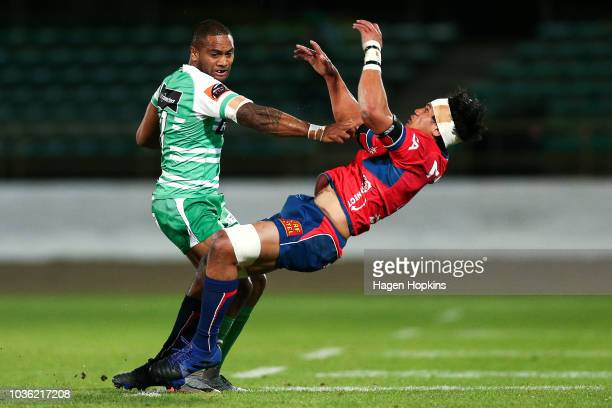 Michael Tagicakibau of Manawatu beats the tackle of Michael Curry of Tasman during the round six Mitre 10 Cup match between Manawatu and Tasman at...