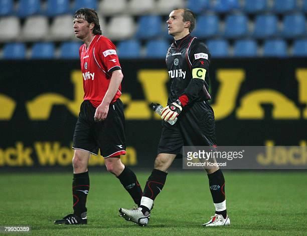 Michael Tarnat and Robert Enke of Hannover walk off the pitch dejected after loosing 12 the Bundesliga match between VfL Bochum and Hannover 96 at...