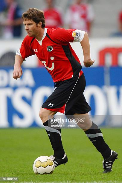 Michael Tarnat of Hannover runs with the ball during the pre season friendly match of Hannover 96 and Arsenal at the AWD Arena on July 29 2009 in...