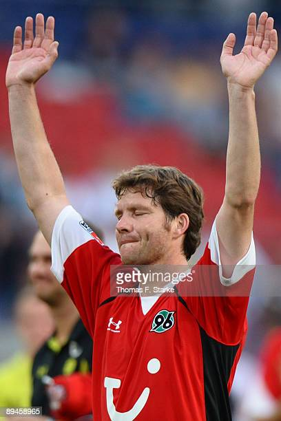 Michael Tarnat of Hannover says goodbye to his supporters during the pre season friendly match of Hannover 96 and Arsenal at the AWD Arena on July 29...