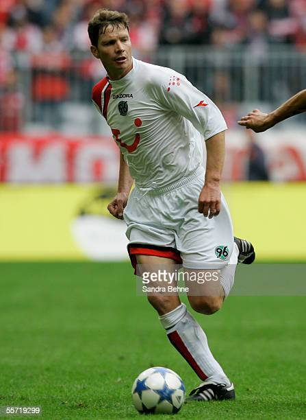 Michael Tarnat of Hanover 96 runs with a ball during the Bundesliga match between Bayern Munich and Hanover 96 at the Allianz Arena on September 17...