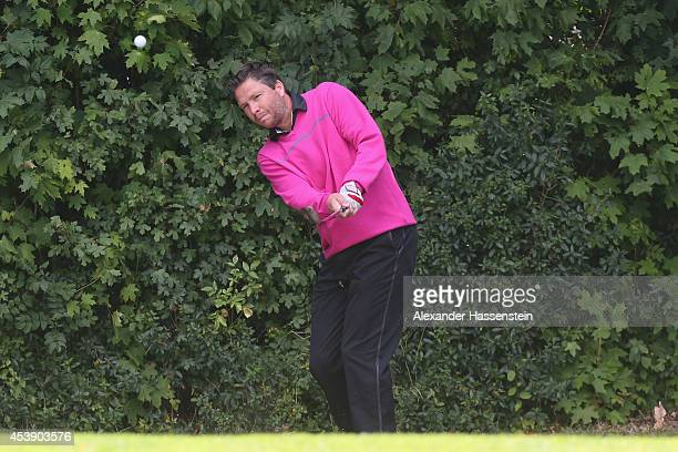 Michael Tarnat plays a shot during the 19th FC Bayern Muenchen Charity Golf Cup at Golf Club Ingolstadt on August 21 2014 in Ingolstadt Germany