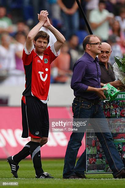 Michael Tarnat who plays his last match today manager Joerg Schmadtke and president Martin Kind attend the pre season friendly match of Hannover 96...