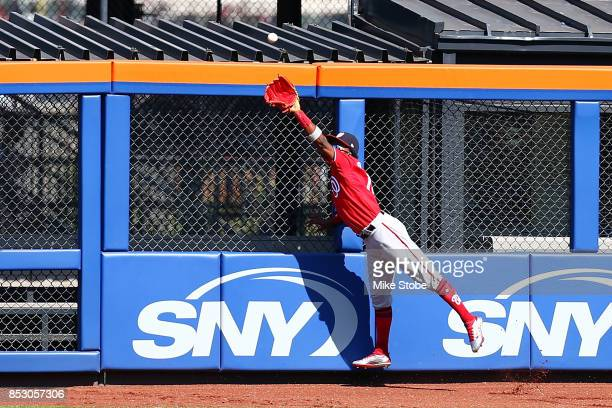 Michael Taylor of the Washington Nationals catches a ball off the bat of Jose Reyes of the New York Mets in the first inning at Citi Field on...