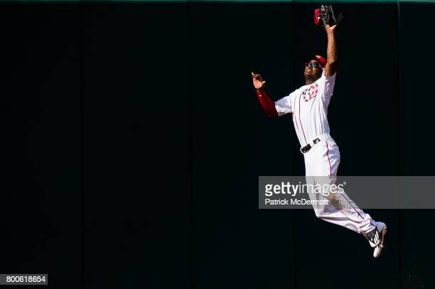 Michael Taylor of the Washington Nationals catches a fly ball hit by Scooter Gennett of the Cincinnati Reds in the third inning during a game at...