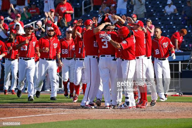 Michael Taylor of the Washington Nationals is congratulated by teammates after hitting a home run to win the game against the Houston Astros in the...