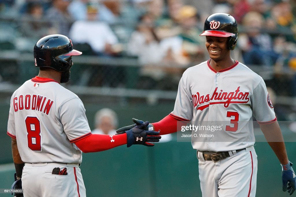 Michael Taylor #3 of the Washington Nationals is congratulated by Brian Goodwin #8 after hitting a home run against the Oakland Athletics during the second inning at the Oakland Coliseum on June 2, 2017 in Oakland, California.