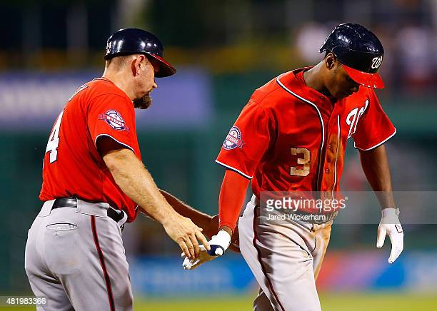 Michael Taylor of the Washington Nationals is congratulated by third base coach Bob Henley after hitting a two run home run in the 8th inning against...