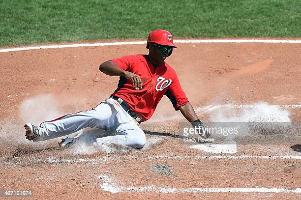 Michael Taylor of the Washington Nationals is safe at home during the third inning of a spring training game against the Atlanta Braves at Champion...