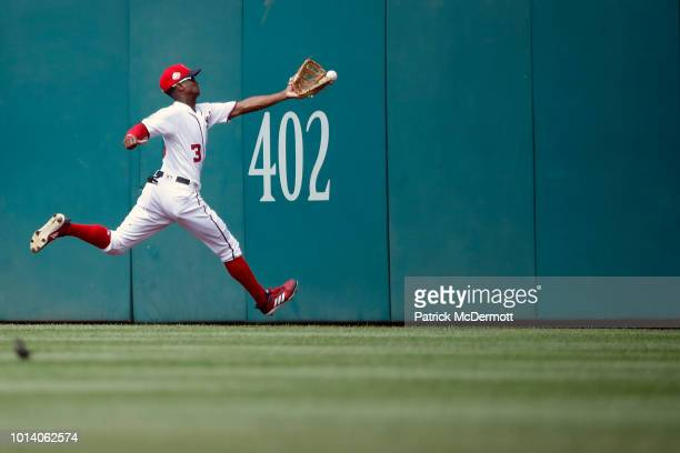 Michael Taylor of the Washington Nationals is unable to catch a double hit by Freddie Freeman of the Atlanta Braves in the eighth inning at Nationals...