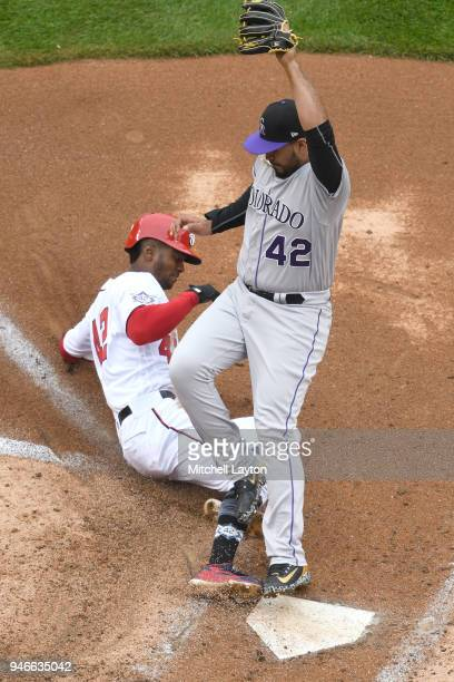 Michael Taylor of the Washington Nationals scores on a passed ball by Chris Iannetta in the fifth inning during a baseball game against the Colorado...