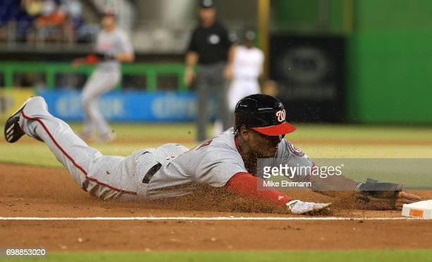 Michael Taylor of the Washington Nationals steals third during a game against the Miami Marlins at Marlins Park on June 20 2017 in Miami Florida