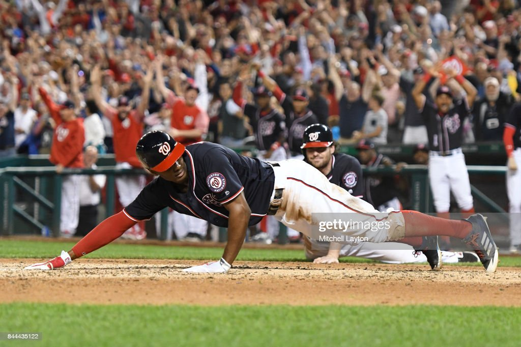 Michael Taylor #3 of the Washington Nationals tags home plate to score on an inside the park grand slam in the third inning during a baseball game against the Philadelphia Phillies at Nationals Park on September 8, 2017 in Washington, DC.