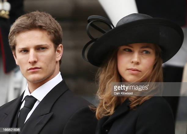 Michael Thatcher and Amanda Thatcher look on from the steps of St Paul's Cathedral as the coffin is placed in the hearse after the Ceremonial funeral...
