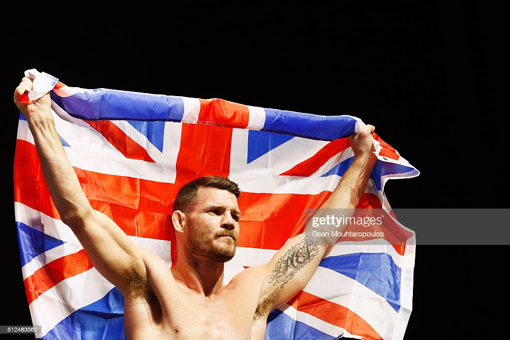 Michael 'The Count' Bisping of England celebrates on stage by flying the Union Jack flag during the UFC Fight Night Weigh-in held at at Indigo at The O2 Arena on February 26, 2016 in London, England. Anderson 'The Spider' Silva of Brazil and Michael 'The Count' Bisping of England will fight tomorrow night in the O2 Arena.