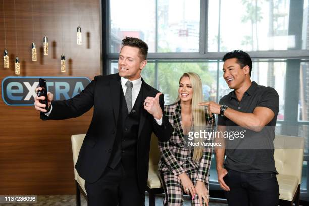 Michael The Miz Mizanin Maryse Ouellet and Mario Lopez visit Extra at Universal Studios Hollywood on March 20 2019 in Universal City California