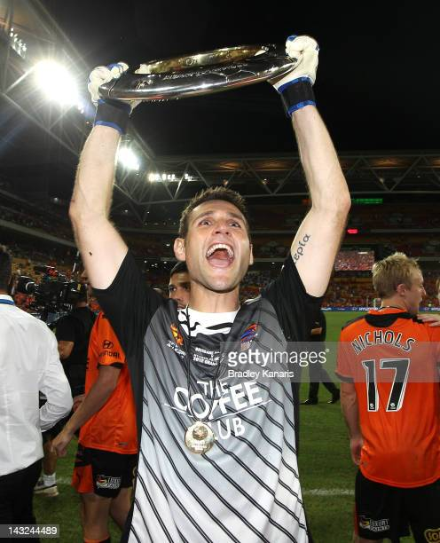 Michael Theoklitos of the Roar celebrates victory after the 2012 ALeague Grand Final match between the Brisbane Roar and the Perth Glory at Suncorp...