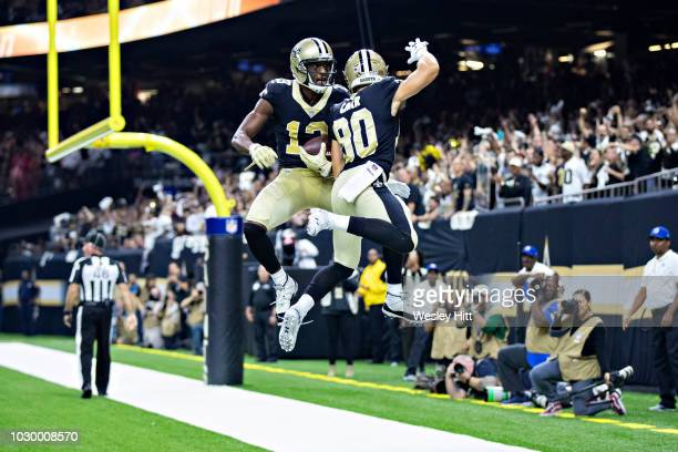 Michael Thomas and Austin Carr of the New Orleans Saints celebrate in the end zone after a touchdown by Thomas during a game against the Tampa Bay...