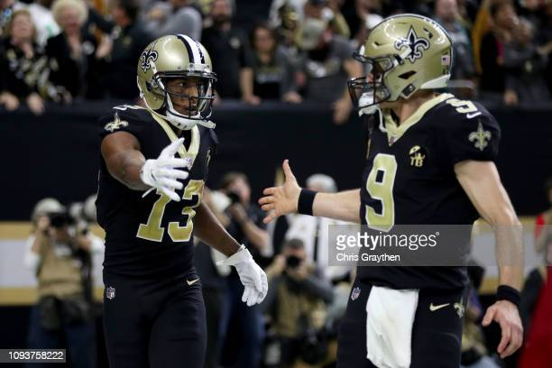 Michael Thomas and Drew Brees of the New Orleans Saints celebrate their third quarter touchdown against the Philadelphia Eagles in the NFC Divisional...